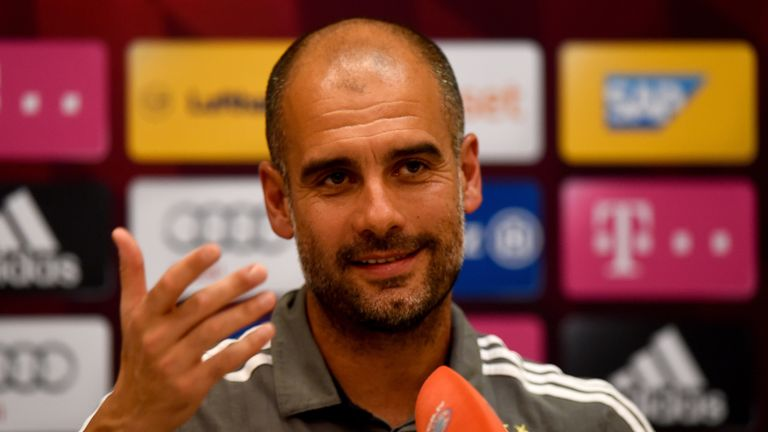 Head coach Pep Guardiola smiles during a press conference at day six of the Bayern Munich training camp at Aspire Academ in Doha, Qatar