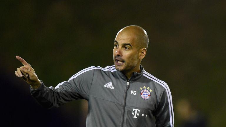 Head coach Pep Guardiola gives instructions