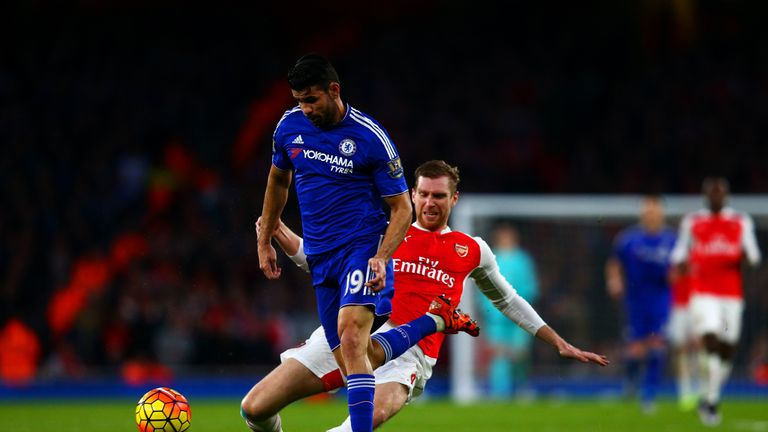 Per Mertesacker fouls Chelsea's Diego Costa and earns himself a red card