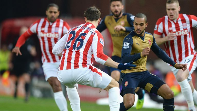 Theo Walcott takes on Stoke's Philipp Wollscheid