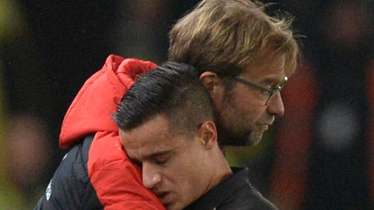 Philippe Coutinho gets a hug from Jurgen Klopp after coming off injured