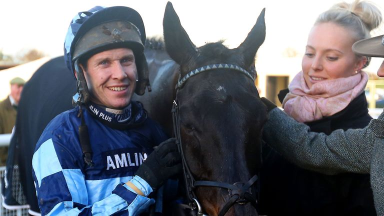 Richard Johnson (left) poses with Garde La Victoire after winning The Racing UK Winter Season Ticket Novices' Steeple Chase at Ludlow Racecourse, Shropshir