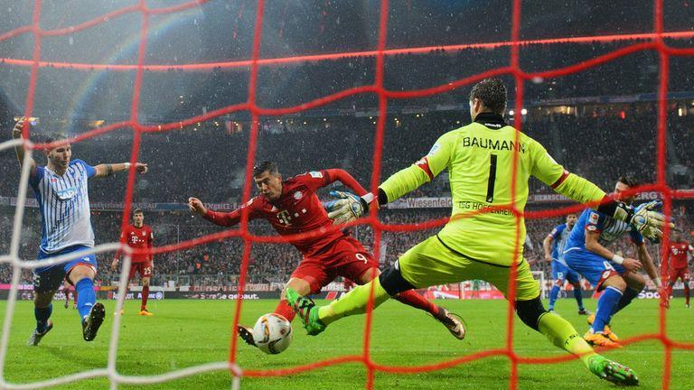 Robert Lewandowski of Bayern Munich (C) scores their first goal