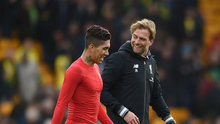 Liverpool manager Jurgen Klopp (right) celebrates with Roberto Firmino
