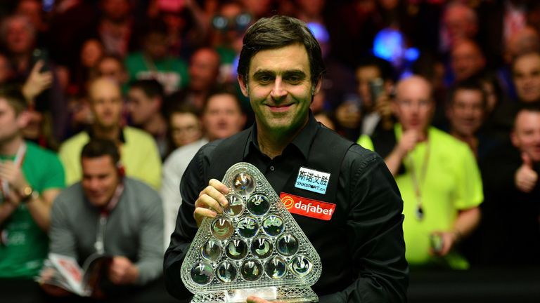 Ronnie O'Sullivan of England poses with the Masters Trophy after defeating Barry Hawkins 10-1 in the final