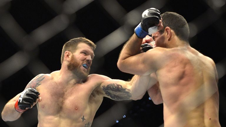 Ryan Bader of the USA punches Anthony Perosh of Australia during their UFC Fight Night Brisbane bout at the Brisbane En