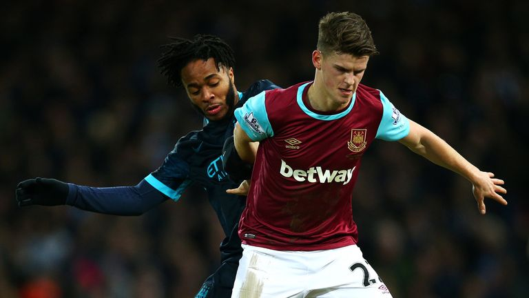 LONDON, ENGLAND - JANUARY 23:  Sam Byram of West Ham United holds off Raheem Sterling of Manchester City during the Barclays Premier League match between W