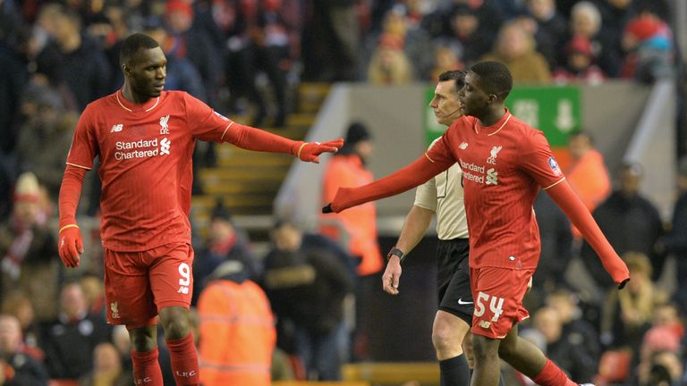 Sheyi Ojo (R) celebrates with Christian Benteke after scoring his first goal for Liverpool