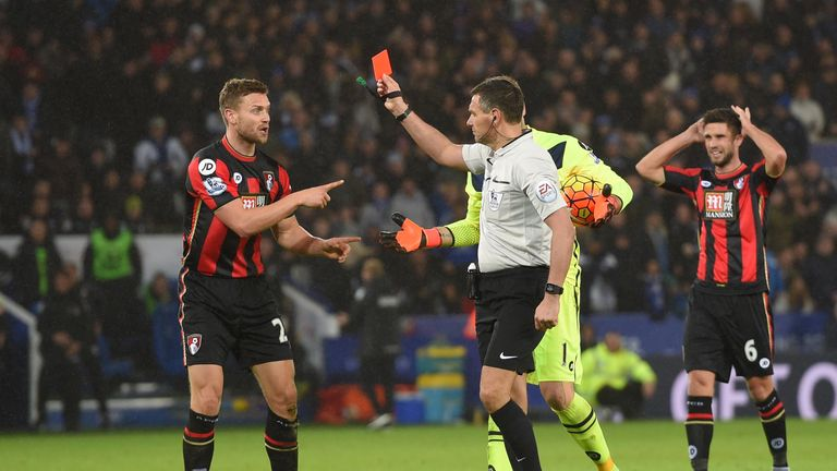 Simon Francis (L) of Bournemouth is shown a red card by referee Andre Marriner after fouling Leicester's Jamie Vardy