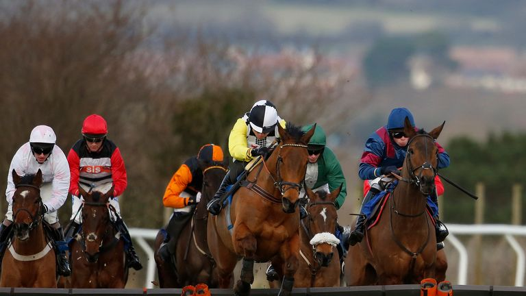 Denis O'Regan and Stop The Press (yellow sleeves) on their way to victory at Taunton.