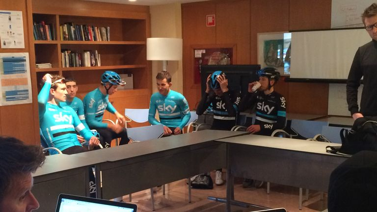 Team Sky's riders await their morning briefing ahead a day of training