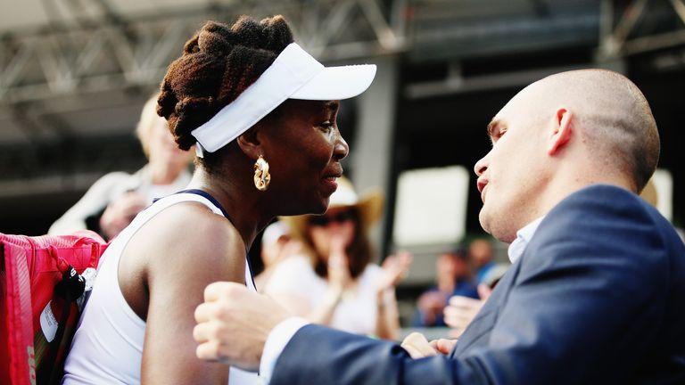 Tournament director Karl Budge comforts Venus Williams