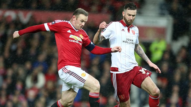 Wayne Rooney of Manchester United in action with David Edgar of Sheffield United