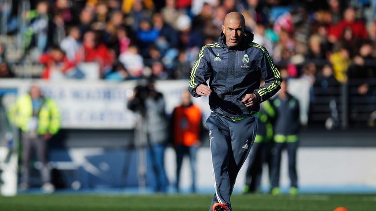 Newly appointed manager of Real Madrid, Zinedine Zidane, passes the ball during a Real Madrid training session