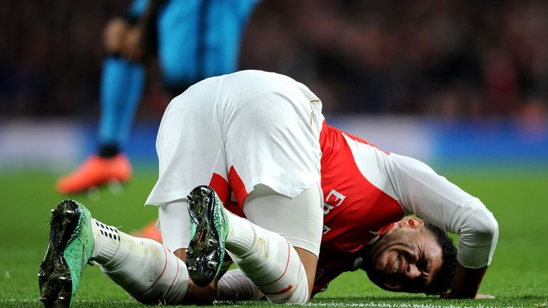 Arsenal's Alex Oxlade-Chamberlain injured during the UEFA Champions League Round of 16, 1st leg match between Arsenal and Barcelona at Emirates Stadium