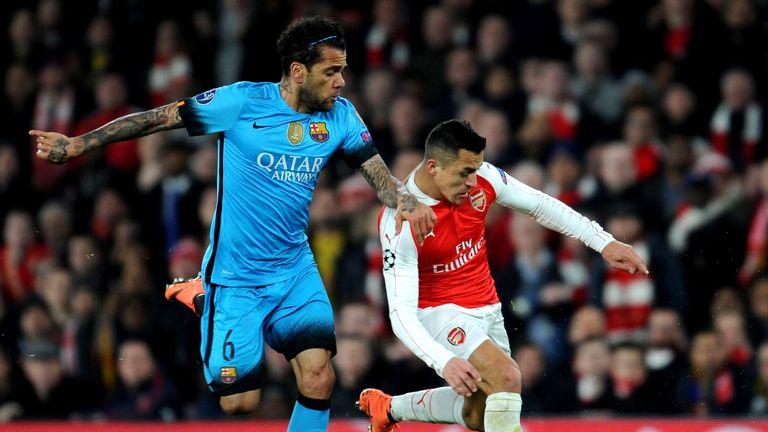 Arsenal's Alexis Sanchez is challenged by Barcelona's Dani Alves