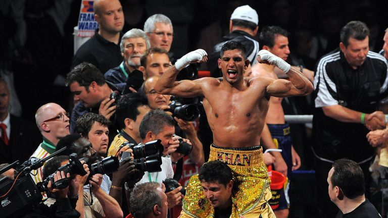 Amir Khan became a world champion for the first time