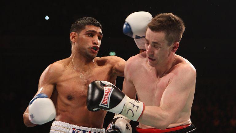 Amir Khan (L) defended his title against Paul McCloskey