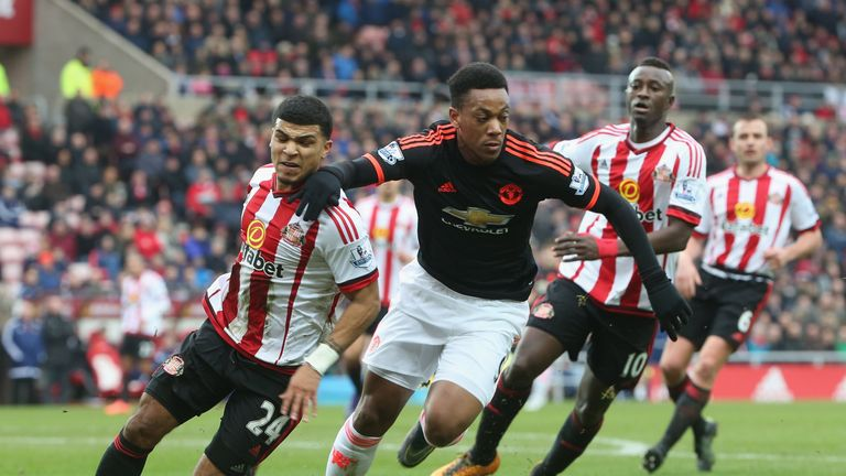 Anthony Martial in action with DeAndre Yedlin at the Stadium of Light