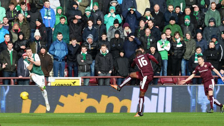 Hearts' Arnauld Djoum (No 16) hits his side's opener just after the half hour