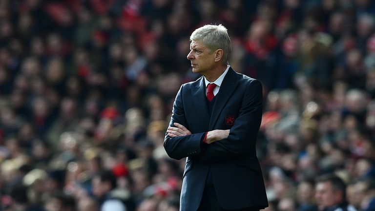 Arsene Wenger watches the action