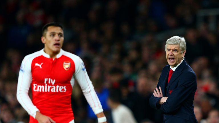 Arsene Wenger, Manager of Arsenal shouts instructions to Alexis Sanchez of Arsenal during the Barclays Premier League match between Arsenal and Chelsea