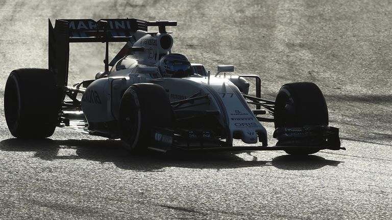Valtterri Bottas cuts through the evening dusk in his Williams