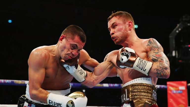 Frampton (R) connects with the uppercut that broke Quigg's jaw