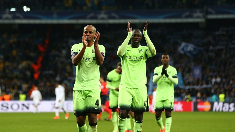 Vincent Kompany and Yaya Toure of Manchester City applaud the travelling fans following their team's 3-1 victory at Dynamo Kiev, Champions League