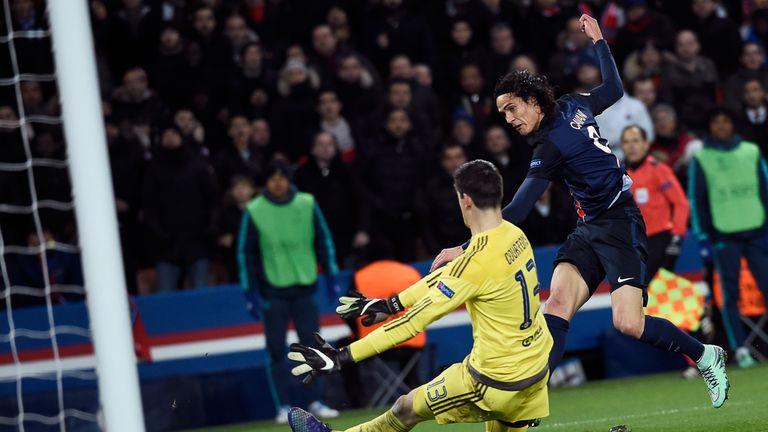 Paris Saint-Germain's Uruguayan forward Edinson Cavani (R) scores a goal past Chelsea's Belgian goalkeeper Thibaut Courtois