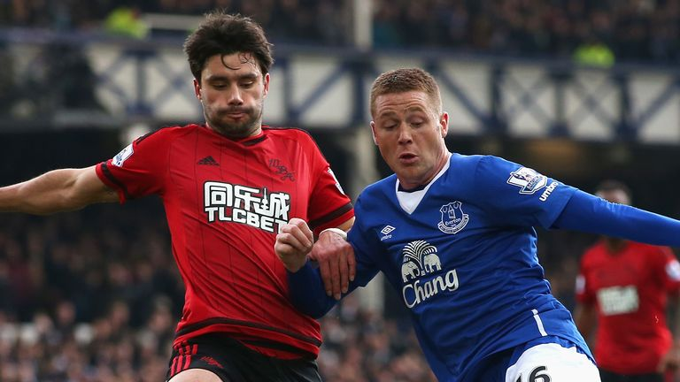 LIVERPOOL, ENGLAND - FEBRUARY 13: James McCarthy of Everton and Claudio Yacob of West Bromwich Albion compete for the ball during the Barclays Premier Leag