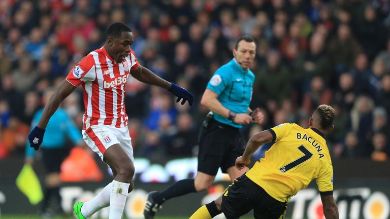 Giannelli Imbula [left] takes the ball past Leandro Bacuna