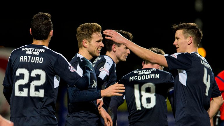 Greig Stewart (second from left) scored a double as Dundee progressed