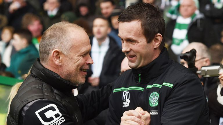 Inverness CT boss John Hughes shakes hands with Celtic manager Ronnie Deila (r)