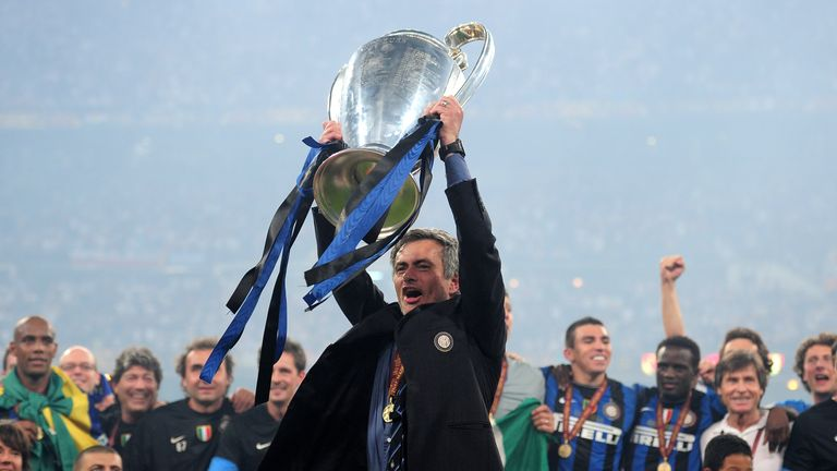 Jose Mourinho the Inter Milan coach holds the trophy aloft after winning the UEFA Champions League