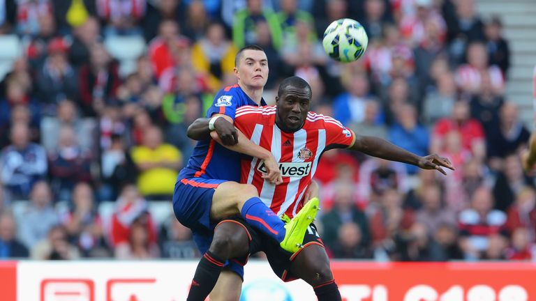 Jozy Altidore of Sunderland is challenged by Michael Keane of Manchester United