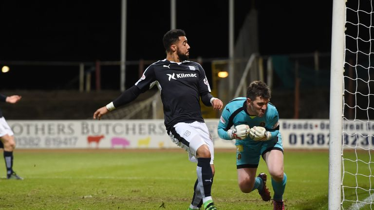 Dundee's Kane Hemmings doubles the lead for his side against Dumbarton