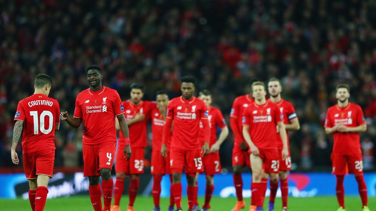 Philippe Coutinho of Liverpool (10) is consoled by Kolo Toure as he misses a penalty in the shoot out during the Capital One Cup