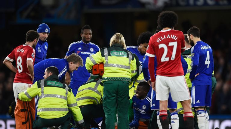 Kurt Zouma is treated after injuring his knee during Chelsea's game against Manchester United