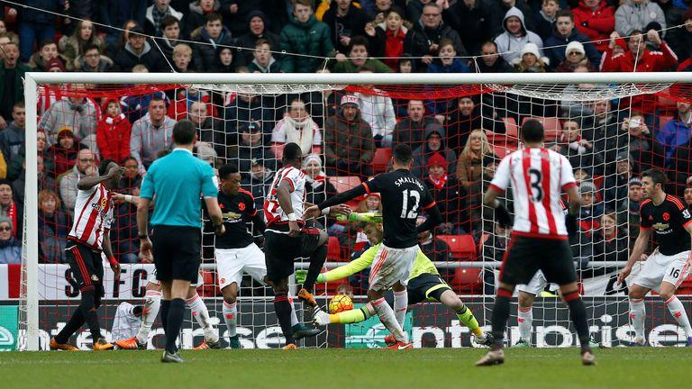 Sunderland's Lamine Kone (left centre) heads the ball in-off Manchester United goalkeeper David De Gea to score their second goal