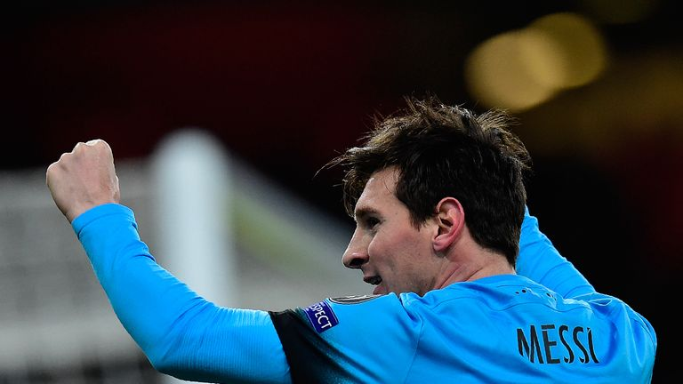 Barcelona's Argentinian forward Lionel Messi celebrates scoring his team's first goal during the UEFA Champions