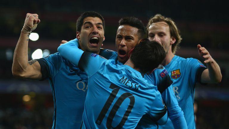 LONDON, ENGLAND - FEBRUARY 23:  Lionel Messi of Barcelona celebrates with Luis Suarez and Neymar