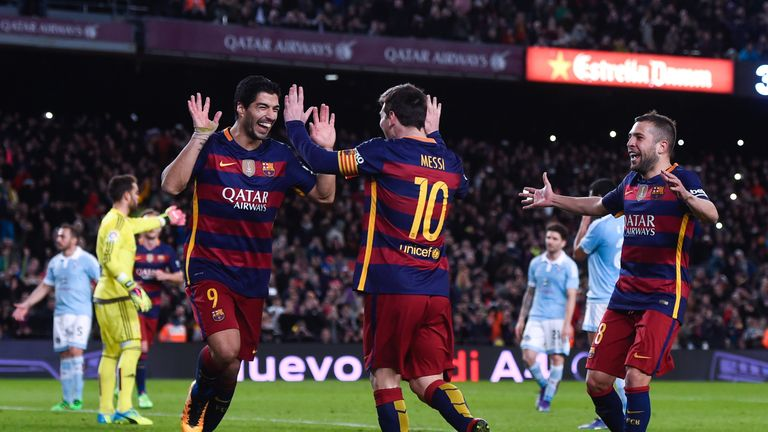Luis Suarez of FC Barcelona celebrates with his team mate Lionel Messi