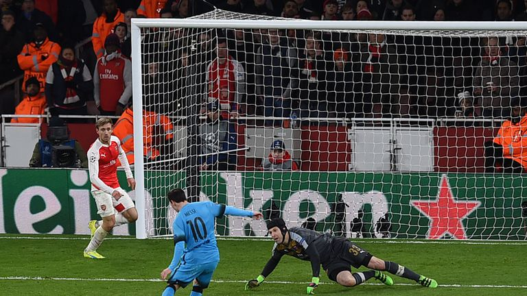 Lionel Messi shoots past Petr Cech to score the first goal in the Barcelona's 2-0 win at the Emirates