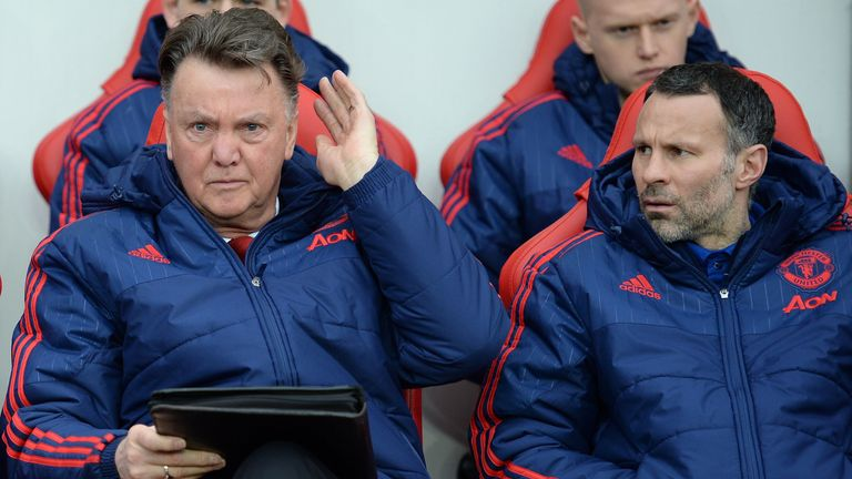 Manchester United's Dutch manager Louis van Gaal (L) and Manchester United's Welsh assistant manager Ryan Giggs