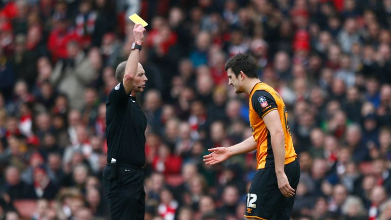 Harry Maguire was shown a yellow card by referee Mike Dean for a dive in the first half