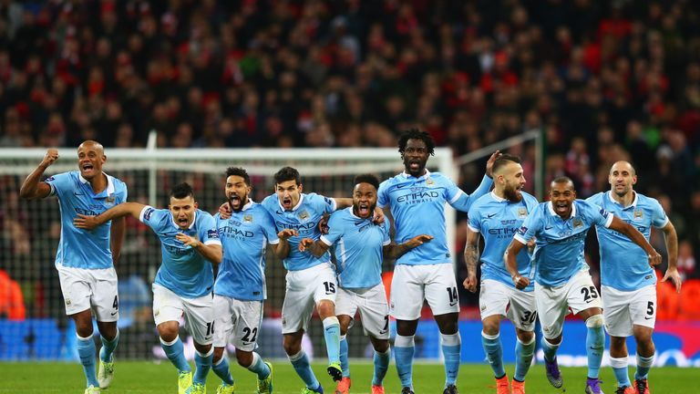LONDON, ENGLAND - FEBRUARY 28:  Manchester City players celebrate as Yaya Toure of scores the winning penalty to win the shoot out during the Capital One C