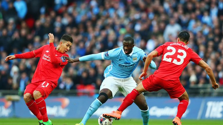 LONDON, ENGLAND - FEBRUARY 28:  Yaya Toure of Manchester City goes between Roberto Firmino (L) and Emre Can of Liverpool (R) during the Capital One Cup Fin