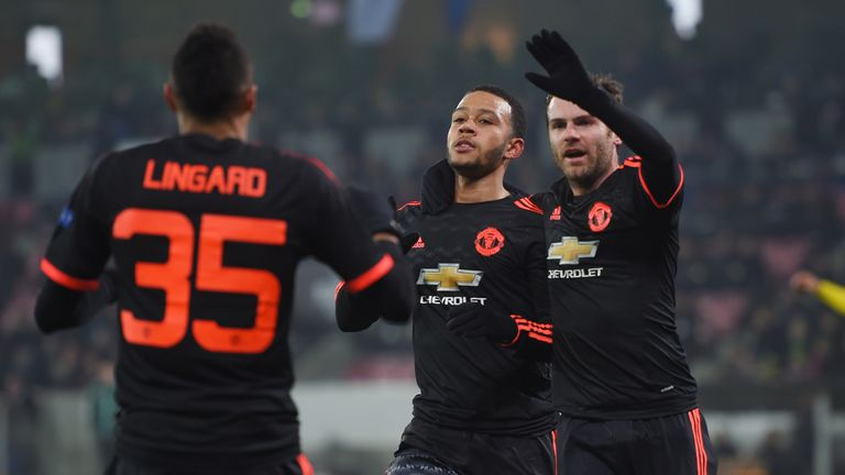 Memphis Depay (C) of Manchester United celebrates scoring his team's first goal with his team mates Jesse Lingard (L) and Juan Mata