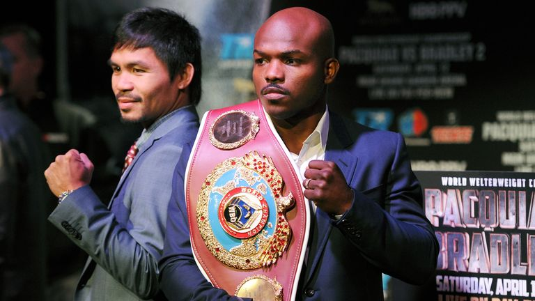 Manny Pacquiao (L) and Timothy Bradley stand for photos during the press conference to promote their upcoming WBO welterweight